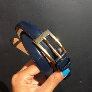 navy leather belt with gold buckle